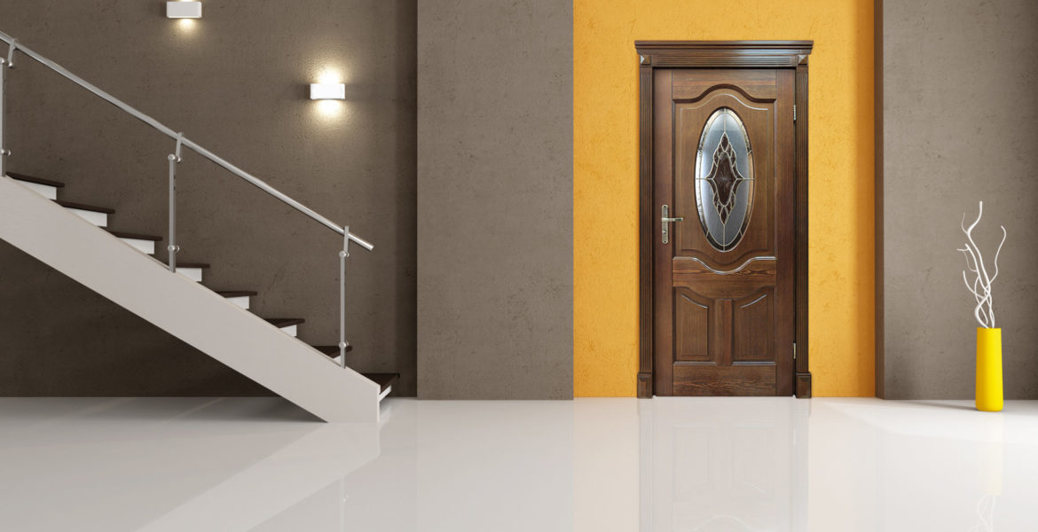 minimalist entrance with white door and staircase